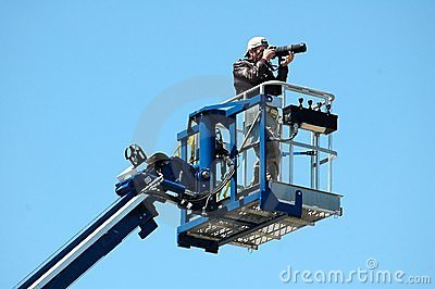 Photographer On A Boom Dock