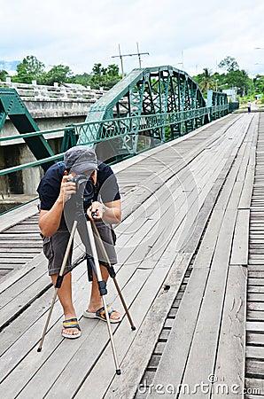 Photographer on Bridge over Pai River at Pai at Mae Hong Son Thailand