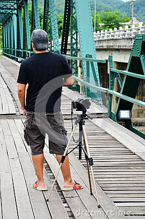 Photographer on Bridge over Pai River at Pai at Mae Hong Son Thailand