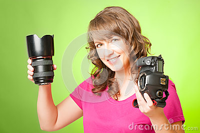 Photographer with camera and lens