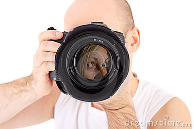 Photographer with camera taking portrait