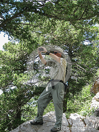 Free Photographer Capturing The Landscape From A High Overlook In The Sandia Mountains Wilderness Area. Stock Photo - 99225360