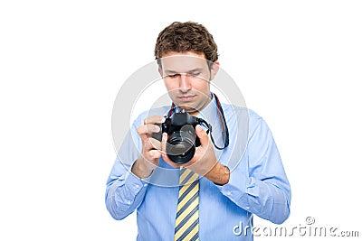 Photographer checks photos on his dslr camera
