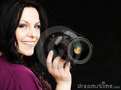 Photographer holding camera over dark