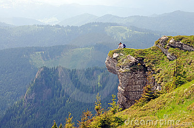 Photographer on a huge rock