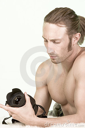 Photographer man with Muscular Build checks camera