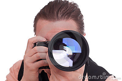 Photographer with reflex camera and telephoto lens