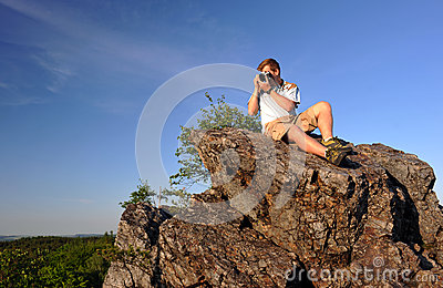 Photographer on a rock
