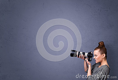 Photographer shooting images with copyspace area Stock Photo