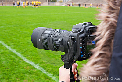Photographer shooting rugby