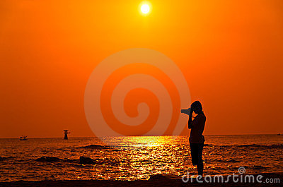 Photographer with sillouette on Hua Hin Beach