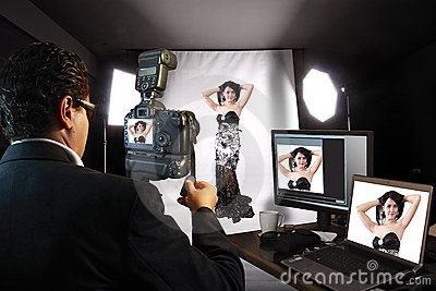 Photographer in Studio with fashion model