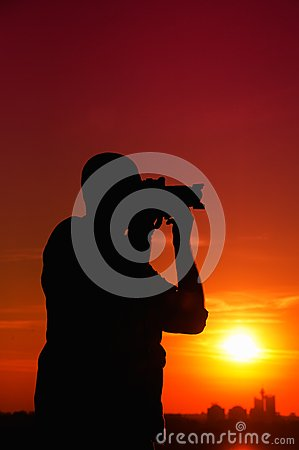 Photographer In Sunset Stock Photo - Image: 27912100