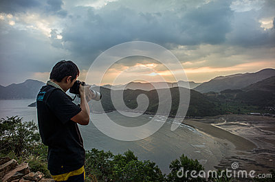 A photographer take photo at intertidal zone