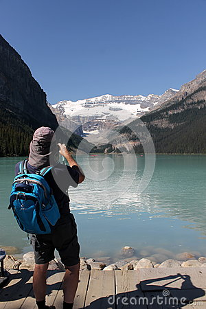 Photographer taking picture of mountains Editorial Stock Image