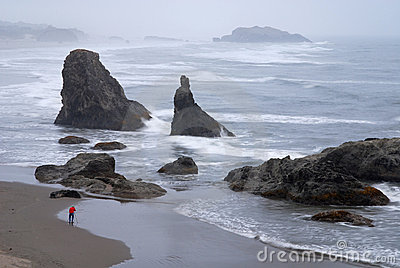 Photographer taking picture of rocks on Oregon Coast