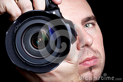 Photographer taking pictures with DSLR
