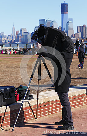 Photographer using vintage camera Editorial Stock Image