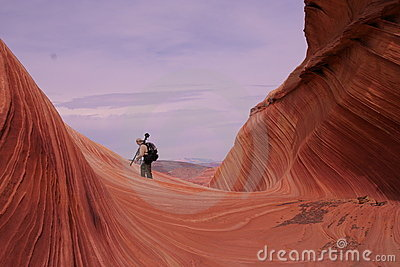 Photographer in Waves of Sandstone