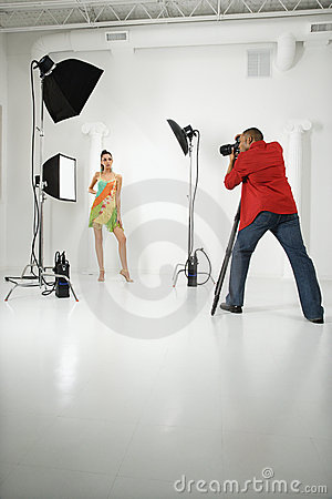 Free Photographer With A Model. Royalty Free Stock Image - 2044446