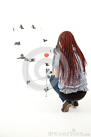 Photographer woman in african braids makes photo