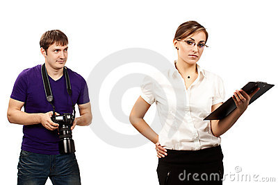 Photographer and a young serious businesswoman