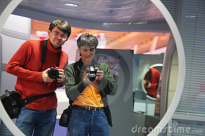 Photographers in curved mirror