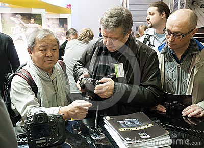 Photographers examine new Nikon products Editorial Image