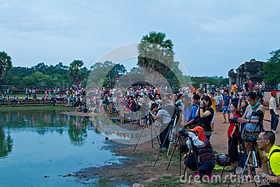 Photographers gather near Angkor Wat pond sunrise Editorial Photo
