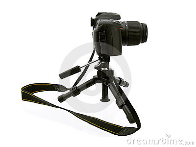 Photographing . Black tripod and camera