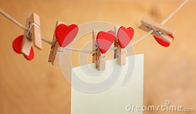Photos and a heart hanging on clothespin