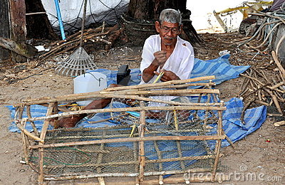 Phuket, Thailand: Fisherman Mending Trap Net Editorial Stock Photo