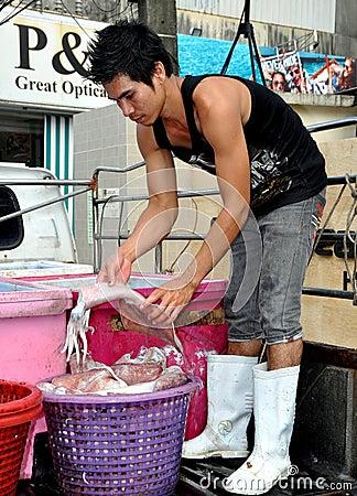 Phuket, Thailand: Fisherman with Squid Editorial Stock Photo