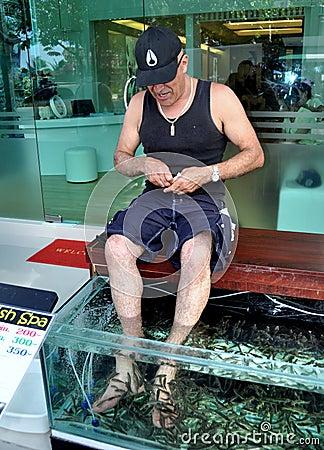 PHUKET, THAILAND: Man Getting Fish Foot Massage Editorial Image