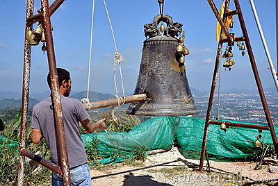 Phuket, Thailand: Man Ringing Bell Editorial Photography