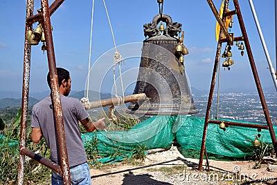 Phuket, Thailand: Man Ringing Bell Editorial Photography