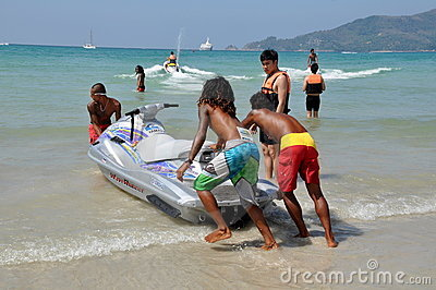Phuket, Thailand: Thai Beachboys and Jetski Boat Editorial Photo