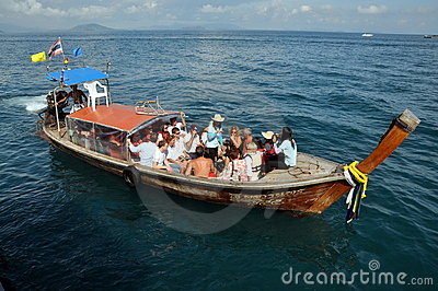 Phuket, Thailand: Tourists on a Longboat Editorial Photography