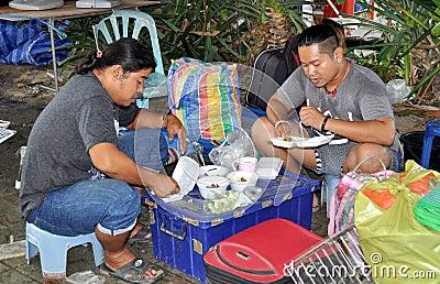 Phuket, Thailand: Two Men Eating Dinner Editorial Image