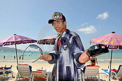 Phuket, Thailand: Vendor Selling Sunglasses Editorial Photo