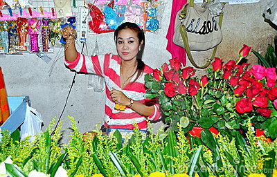 Phuket, Thailand: Woman Selling Roses Editorial Photo
