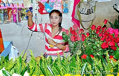 Phuket, Thailand: Woman Selling Roses Editorial Photo