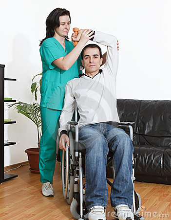 Physical therapist working with patient