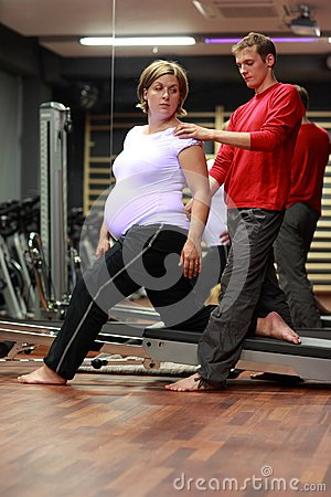 Physical therapist working with pregnant woman
