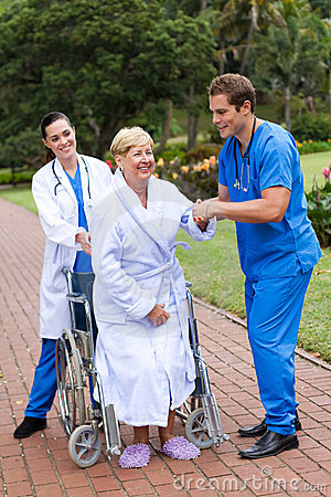 Physical therapists helping patient walk