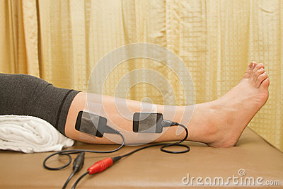 Physical therapy , woman with eletrical stimulator