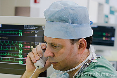 Physician with phone in ICU