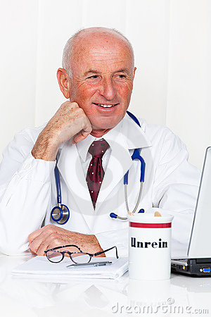 Physician in practice with stethoscope and laptop.
