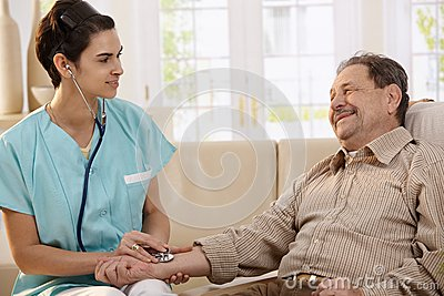 Physician using stethoscope