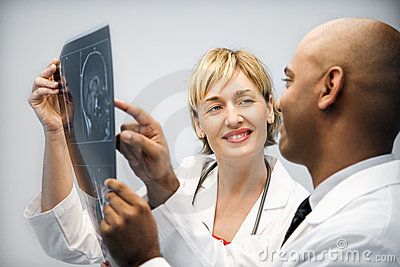 Physicians analyzing xray.